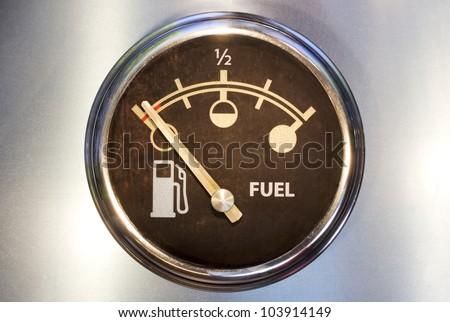 Vehicle fuel gauge on empty. - stock photo