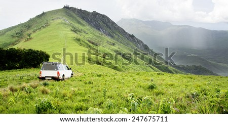 Vehicle in Rainy Weather at Jalawe Rock, Nyika Plateau, Malawi, Africa - stock photo