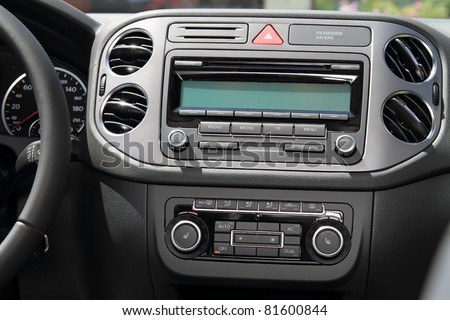 Vehicle instrument panel console and car stereo radio.