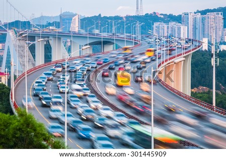 vehicle motion blur on the bridge,  traffic is busier during rush hour - stock photo