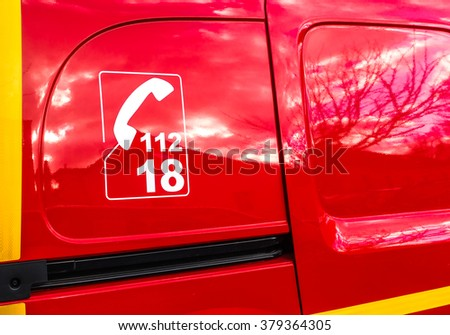 Vehicle of Fireman. France - February 15th, 2015. The 112 and the 18, are the two emergency numbers to alert the firemen in the event of fire, of flood or assistance to the people in danger. - stock photo
