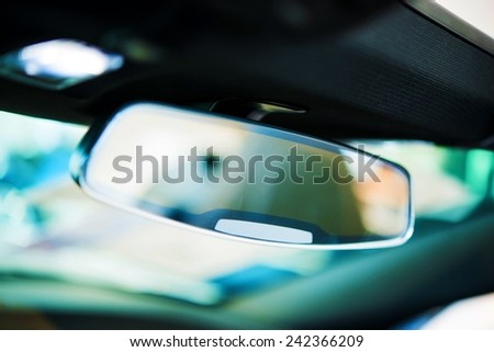 Vehicle Rear View Mirror. Car Interior Safety Feature Closeup - stock photo