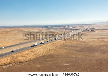 Vehicle�s travel across an open interstate freeway - stock photo