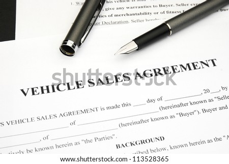 Vehicle Sales agreement document form with pen - stock photo