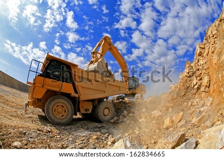 vehicles in action on a construction site - stock photo