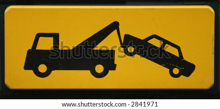 Vehicles will be towed - Traffic Warning Sign - stock photo