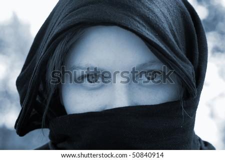 Veiled Woman. Sepia tone. - stock photo