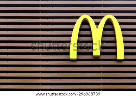 Vejle, Denmark - July 4, 2015: Mc Donald's logo on a striped facade - stock photo