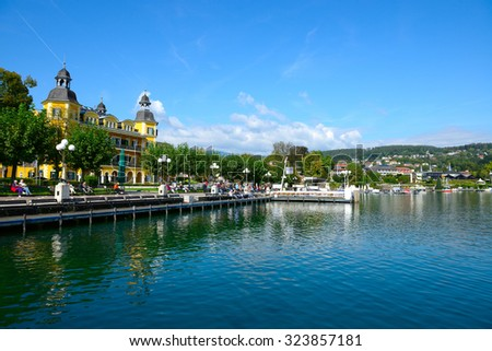 VELDEN, AUSTRIA - SEPTEMBER 27,2015:View of the waterfront in village Velden, Auctria. Situated at the western shore of the Worthersee lake it is one of the country's most popular holiday resorts. - stock photo