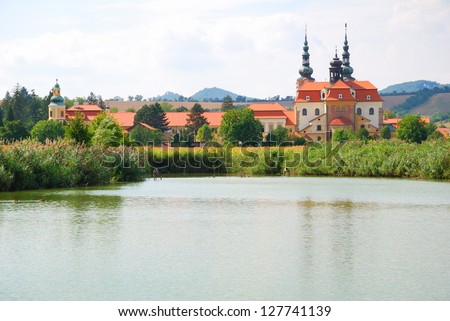 Velehrad Christian Cathedral and a small pond - stock photo