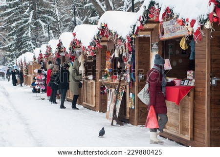 VELIKO TARNOVO, BULGARIA - DECEMBER 20: Random shoppers stroll along the specially established Christmas bazaar in Veliko Tarnovo, Bulgaria on December 20, 2012. - stock photo