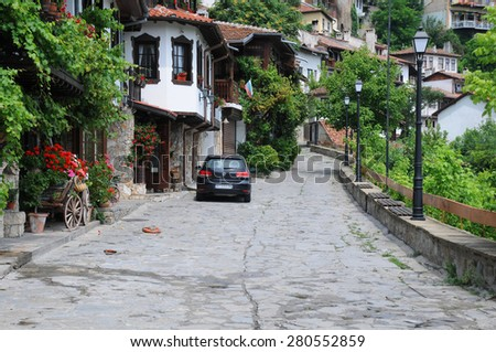 VELIKO TARNOVO, BULGARIA - JULY 16, 2014: Traditional Bulgarian houses in General Gurko Street in the Old Town - stock photo