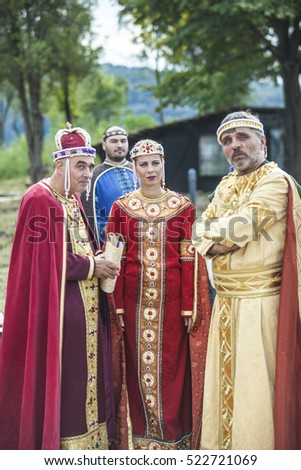 Veliko Tarnovo, Bulgaria - September 21, 2016: Actors dressed in medieval costumes recreate what they looked Bulgarian king, queen and courtiers in the palace Tsarevets in Veliko Tarnovo