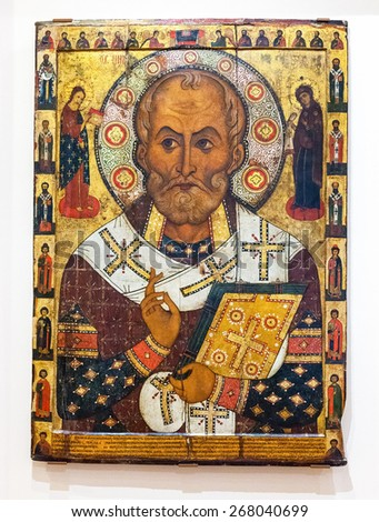 VELIKY  NOVGOROD, RUSSIA - JULY 24, 2014: Antique Russian orthodox icon of Saint Nicolas painted on wooden board - stock photo