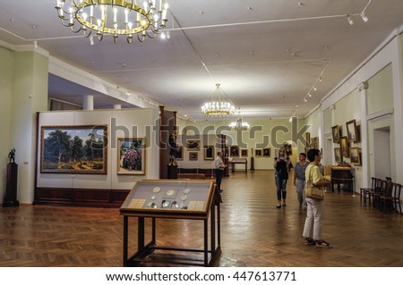 VELIKY NOVGOROD,RUSSIA-JULY 1, 2016. Unidentified museum visitors look exhibits in the showroom of Art Museum of Veliky Novgorod