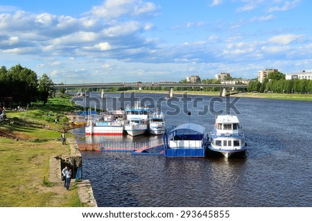 VELIKY NOVGOROD, RUSSIA - JUNE 12, 2015. Water area of the Volkhov river and pleasure boats standing at the dock at summer sunset