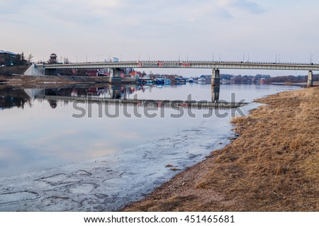 VELIKY NOVGOROD, RUSSIA - MARCH 26, 2016. Road bridge across the Volkhov river in Veliky Novgorod, Russia - the inscription Veliky Novgorod 1156 - city landscape in the spring quiet evening
