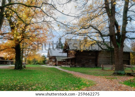 VELIKY NOVGOROD, RUSSIA - OCTOBER 6, 2012 .  Autumn landscape with the old wooden churches and peasant hut  at the Museum of Wooden Architecture Vitoslavlitsy (soft focus processing) - stock photo