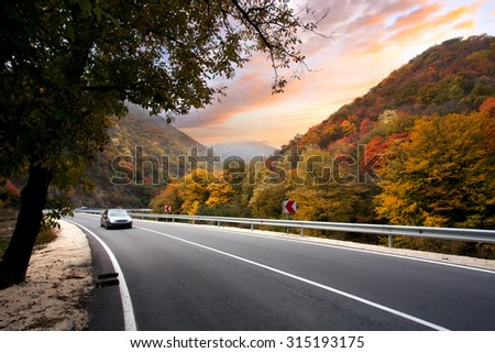 VELINGRAD, SEPTEMBER 10: Volkswagen VW Golf 4 car on autumn road, car is blurred from the speed on September 10, 2015 at Velingrad, Bulgaria. - stock photo