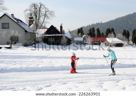 VELKE KARLOVICE, CZECH REPUBLIC - JANUARY 28, 2012: Cross country skiers run on Karlovice tracks. - stock photo