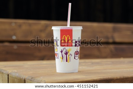 VELKE KARLOVICE, CZECH REPUBLIC - JANUARY 1, 2015: McDonalds plastic cups for soda. McDonald's Corporation is the world's largest chain of hamburger fast food restaurants. - stock photo