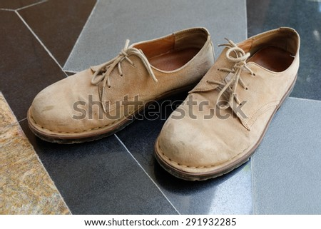 Velvet brown leather shoes - stock photo