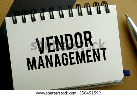 Vendor management memo written on a notebook with pen