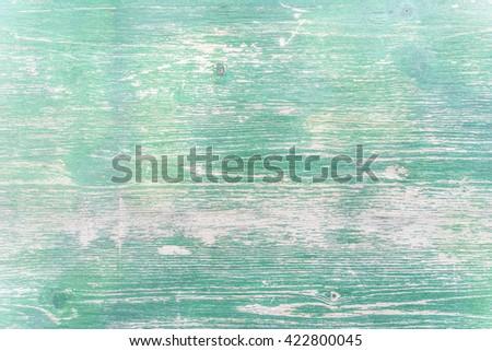 Veneer peeling paint dark green color painted old wood wall texture background - stock photo