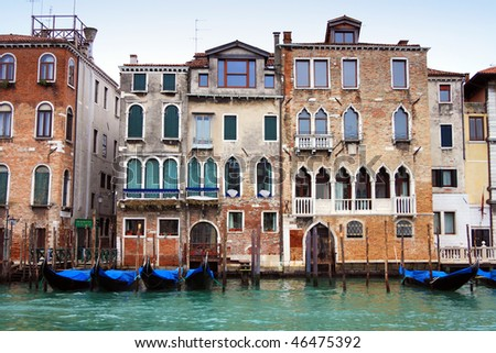 Venetian buildings and gondolas along Canal Grande, Venice, italy