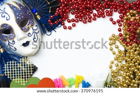 Venetian carnival mask and beads for party. room for text  - stock photo