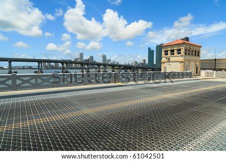 Venetian Causeway Drawbridge in Miami with Skyline and MacArthur Causeway bridge in the background. - stock photo