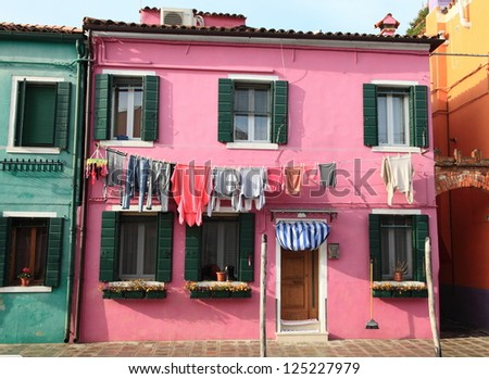 Venetian colorful houses along the canal of Burano Island of Venice, Italy - stock photo