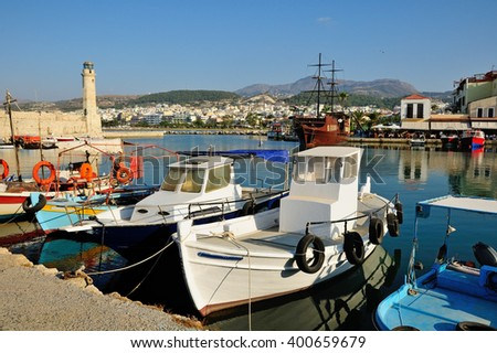 Venetian harbour and lighthouse in city of Rethymno, Crete, Greece - stock photo
