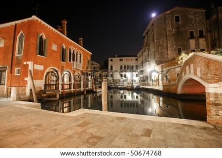 Venetian houses and canal at night in the streets of Venice, Italy