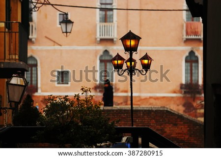 Venetian lantern and lonely girl, Venice Italy