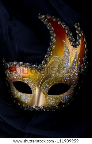 Venetian mask, gold and red, carnival, venice - stock photo