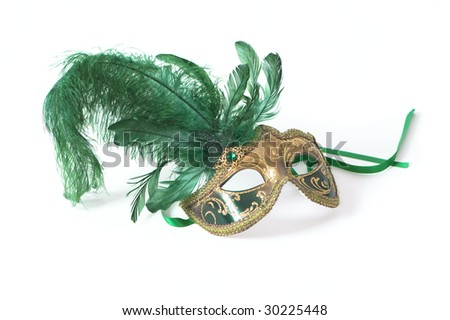 Venetian mask with green feather on white background - stock photo