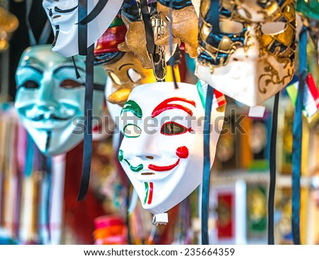 Venetian masks in store display in Venice. Annual carnival in Venice is among the most famous in Europe. Its symbol is the Venetian mask - stock photo
