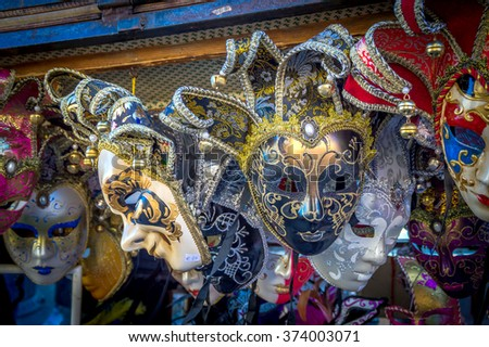 Venetian masks on display/sale for the carnival in Italy. Artistic dark edit with a strong vignette.