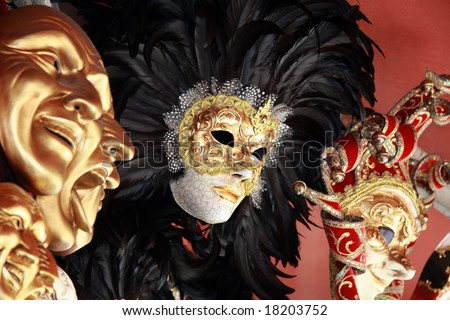 Venetian masks with black feathers on a red background - stock photo