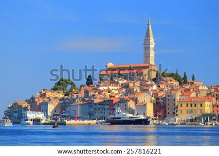Venetian old town with tall belfry in sunny day, Rovinj, Istria peninsula, Croatia - stock photo