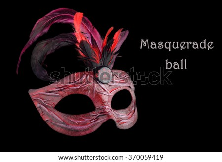 Venetian red Carnival half mask with feathers on black background.  More masks at http://www.shutterstock.com/sets/13916221-masks.html?rid=2867935 - stock photo