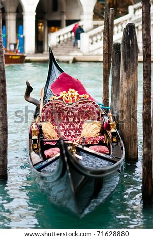 Venetian typical boat - gondola - in the harbor - stock photo
