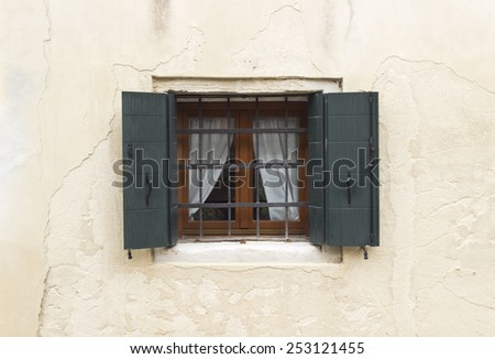 venetian window wall background. traditional facade - stock photo