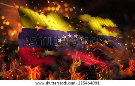 Venezuela Burning Fire Flag War Conflict Night 3D - stock photo