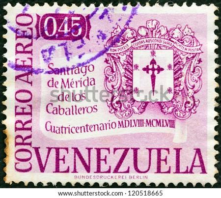 VENEZUELA - CIRCA 1958: A stamp printed in Venezuela issued for the 400th anniversary of Santiago de Merida de los Caballeros shows Arms of Santiago de Merida, circa 1958. - stock photo