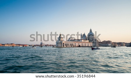 Venice at sunset. Basilica di Santa Maria della Salute. - stock photo