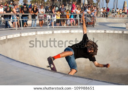 VENICE-AUG 4: A skateboarder practices without a helmet at the Venice Skatepark in Venice,CA on Aug. 4, 2012. Skateboarding injuries cause more than 50,000 yearly visits to emergency rooms in the US. - stock photo
