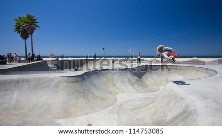 VENICE BEACH, CA - AUG 14:  Skateboarder at landmark skatepark at Venice Beach, CA seen on Aug. 14, 2012. This 16,000 sq. foot skatepark is one of the only in the world located on a beach. - stock photo