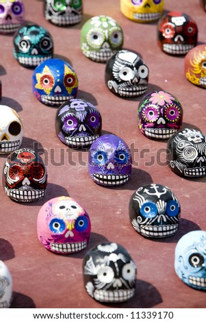 "Venice Beach, CA March 8, 2008:  Painted papier mache skulls celebrating ""Dia de los Muertes"" (Day of the Dead) on sale at Venice Beach. - stock photo"